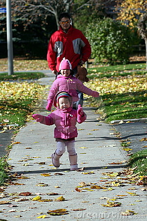 Father and Daughters Walking