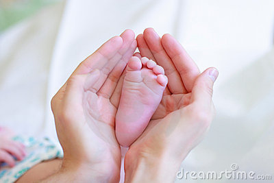 Father gently hold baby s leg in your hands #2