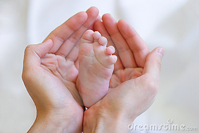Father gently hold baby s leg in your hands