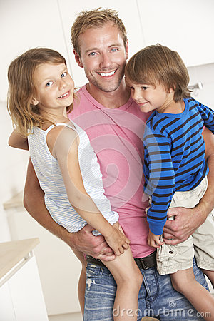 Free Father Giving Children Cuddle At Home Stock Photo - 54972920