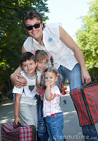 Father and group children in park with case.