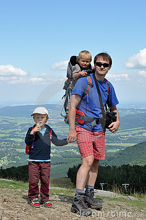 Father hiking with children