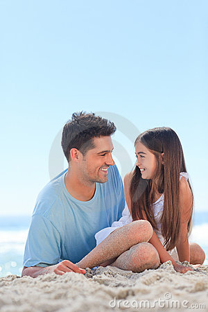 Father with his daughter at the beach