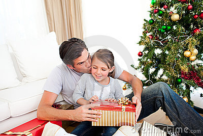 Father and his daughter opening Christmas presents