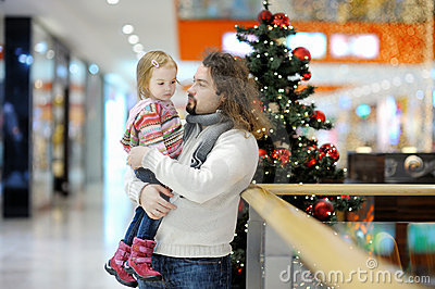 Father and his girl in shopping mall on Christmas