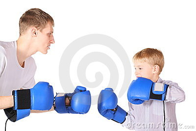 Father and his son is boxing with boxing gloves