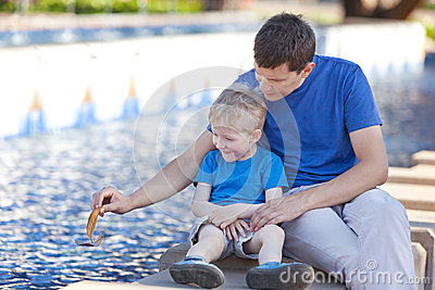 Father and his son by the fountain
