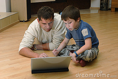 Father and his son with laptop