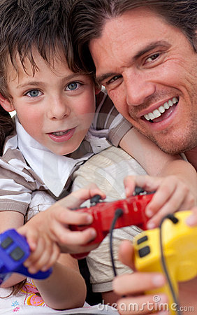 Father and his son playing video games