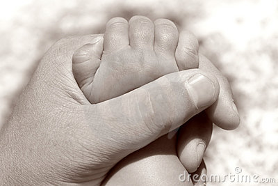 Father holding baby s hand