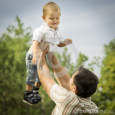 Father holding son in air