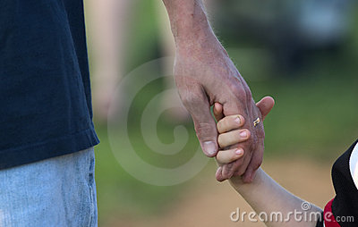 Father holding son s hand