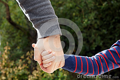 Father holds daughter s hand