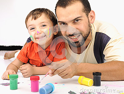 Father and kid playing with colors