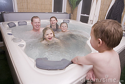 A father and kids in hot tub