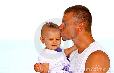 Father kissing his baby girl