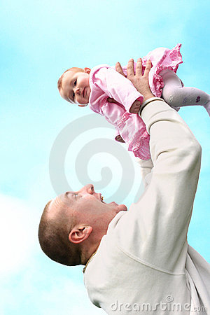 Father lifts his baby girl