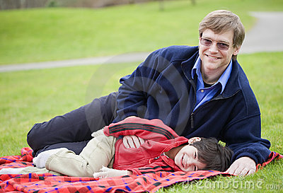 Father lying on blanket with son
