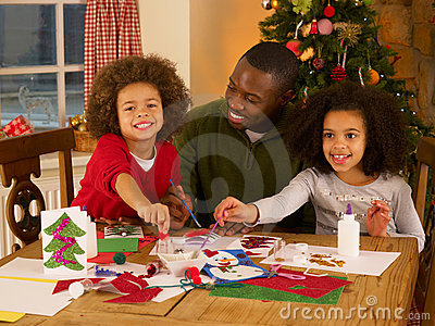 Father making Christmas cards with children