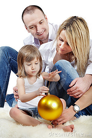 Father, mother and daughter holds ball Stock Photo