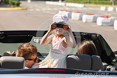Father, mother and daughter ride in car