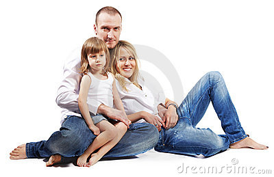 Father, mother and daughter sit on floor