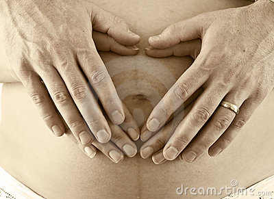 Father and mother hands on tummy