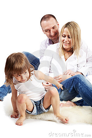Father, mother and little daughter sit on carpet Stock Photo