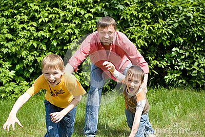 Father playing with two children