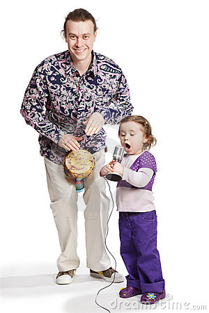 Father plays on djembe, daughter sings Stock Photo