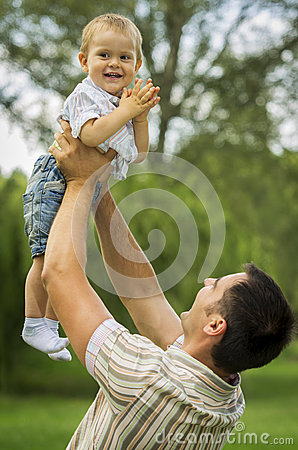 Father raising son in air