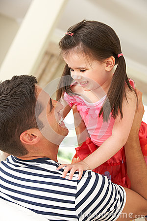 Father Relaxing At Home With Daughter
