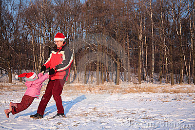 Father rotate daughter in winter