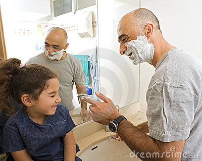 Father shaving and doughter watching