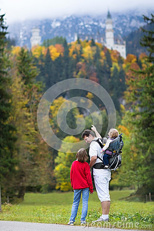 Father showing his kids the Neuschwanstein Castle