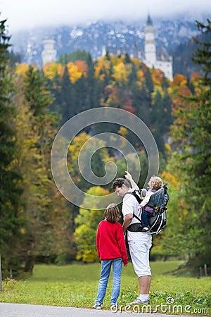 Father showing his kids the Neuschwanstein Castle