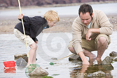 Father and son at beach fishing