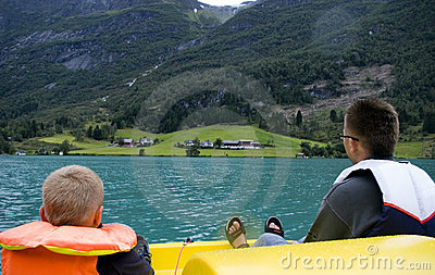 Father and son boating on lake