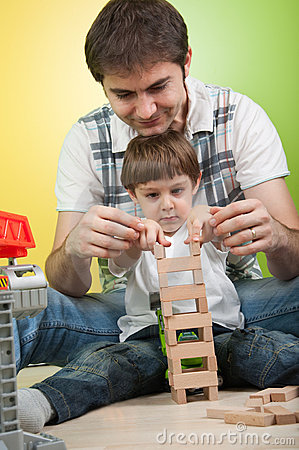 Father and son building a toy tower