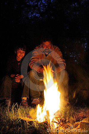 Father and son campfire