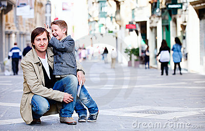 Father and son in city