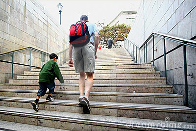 Father and son climb stairs