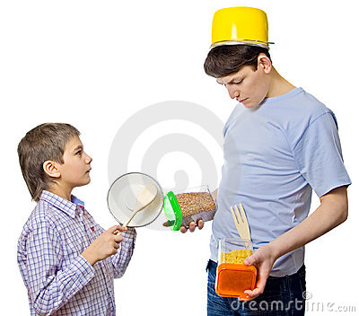Father and son cooking together