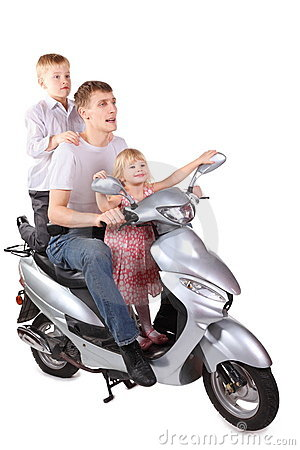 Father and son, daughter is sitting on motorcycle