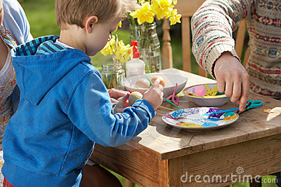 Father And Son Decorating Easter Eggs