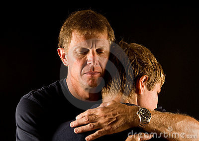 Father and son in emotional hug