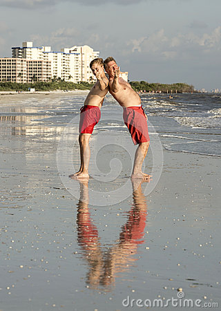 Father and son enjoy the beach