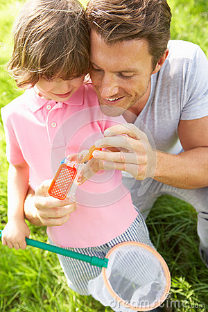 Father And Son In Field With Net And Bug Catcher