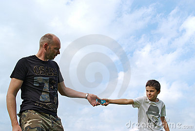 Father and son fighting over a cellphone