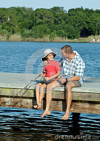Father and Son Fishing on Wooden Pier